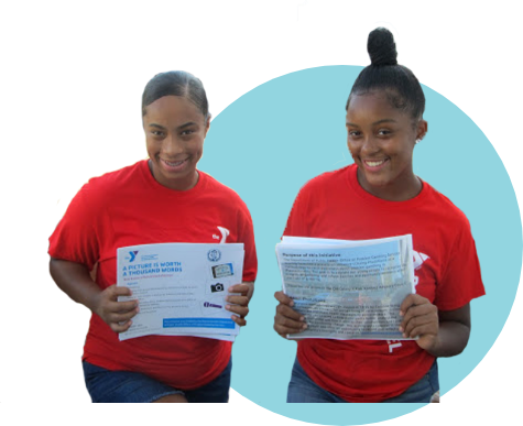 two girls with papers